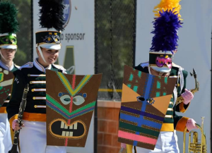 During the percussion section's solo at finals, some band members provided visual effects with masks while the color guard provided a flag routine to accompany the music.