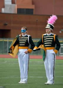 Seniors Kyle Timmons and Maggie Schulhoff lead the band during the MSBA finals on Nov. 7 in Norwood's Shea Stadium. Timmons is the Drum Major/Field Commander, and Schulhoff is the leader of the band's percussion section.