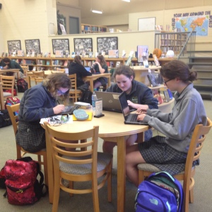 McNick students working on their tablets in the library. The tablet program allows students to access their homework, notes, and books anywhere. The tablets also have the capability of on-screen writing with a stylus, as well as standard laptop typing.